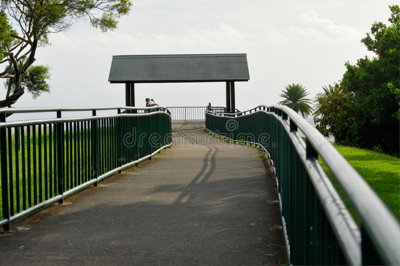 Metal railing surrounds a walkway to a lookout royalty free stock image