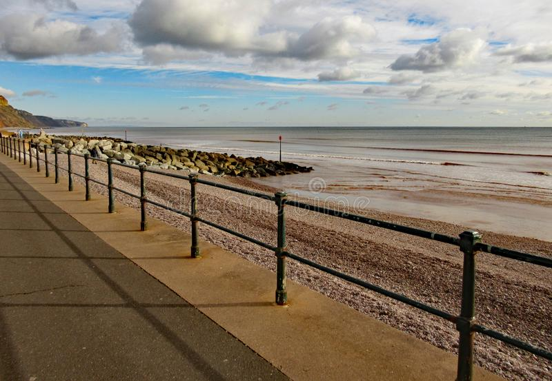 Metal railings on Sidmouth Esplanade, to stop people falling on to the pebble beach some 3 metres below.  stock images