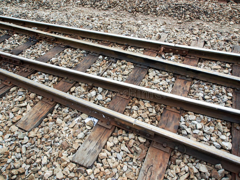 Metal rails and wooden sleepers stock image