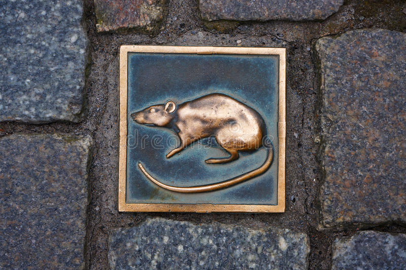 Metal rat - symbol of city Hameln in Germany. The metal rat - symbol of city Hameln in Germany under the legend of the Pied Piper of Hamelin stock photography