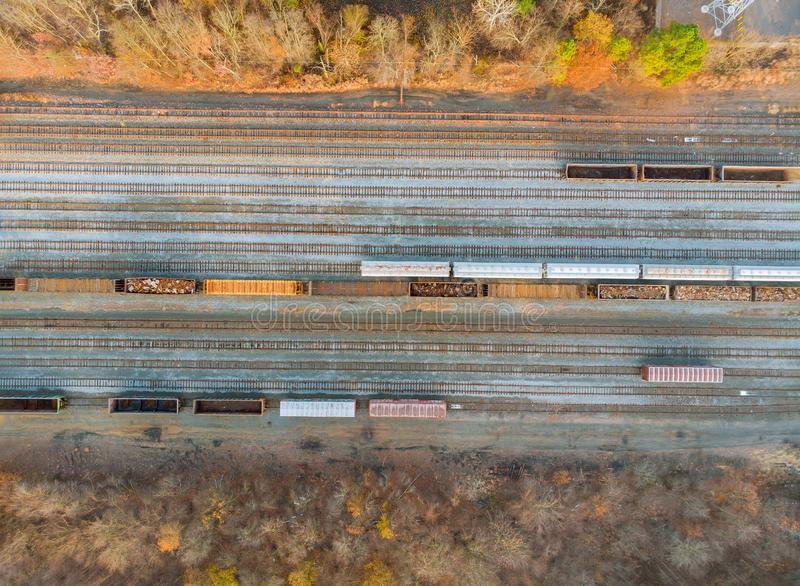 Metal recycling from industrial work drone above view on railway wagon filled with scrap metal stock photography