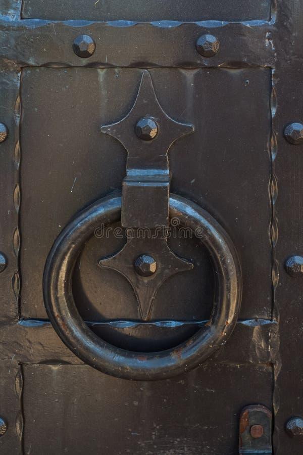 The ring handle on the metal door. stock photo