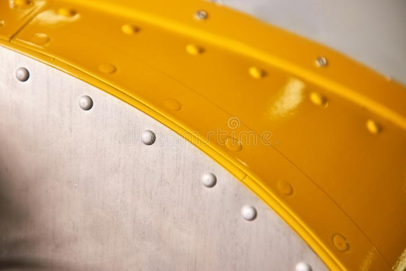 Metal with rivets macro. Airplane body close up royalty free stock photo