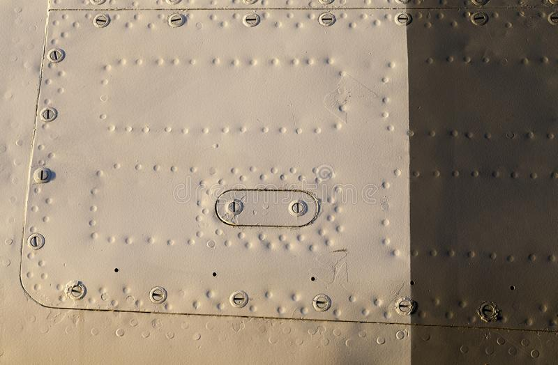 Metal rivets. Of different colors, part of the aircraft, riveted royalty free stock photos