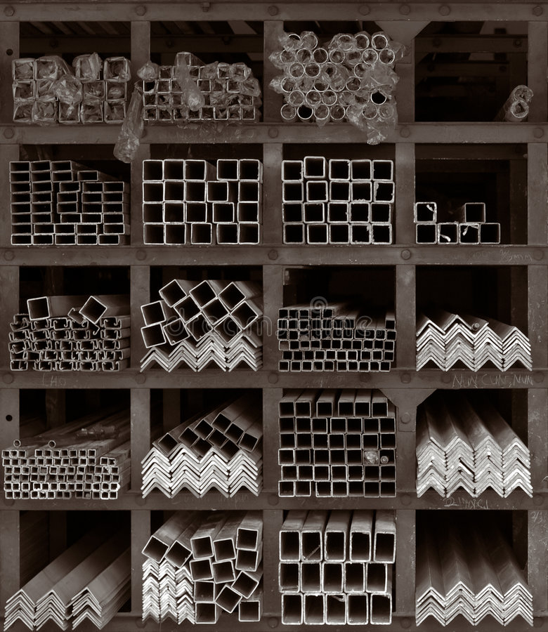 Metal Rods Storage Shelves. Square compartments constructed from rusty iron beams creating storage shelves densely packed with metal rods of various material and stock photo