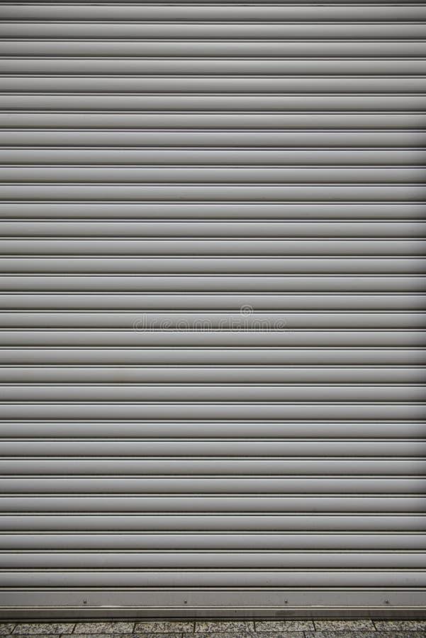 Metal roller shutter door of store closed stock photos