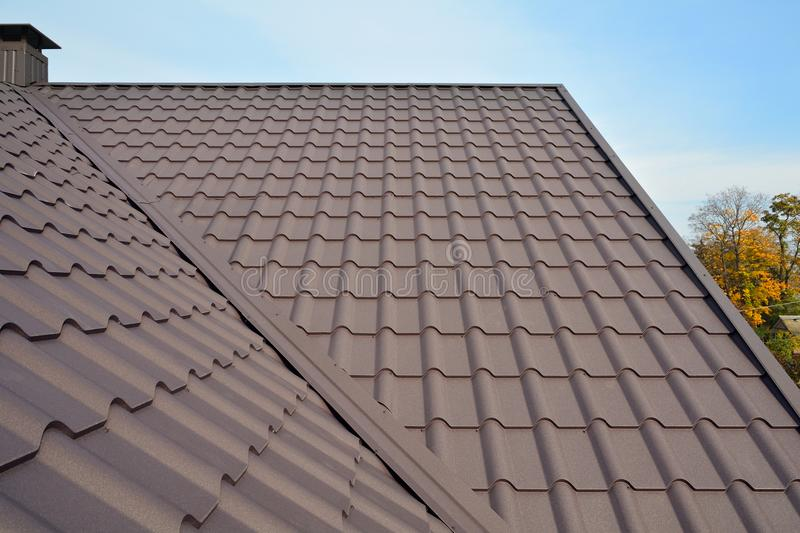 Metal Roof Construction Against Blue Sky. Roofing materials. Metal House roof. Closeup House Construction Building Materials. stock image