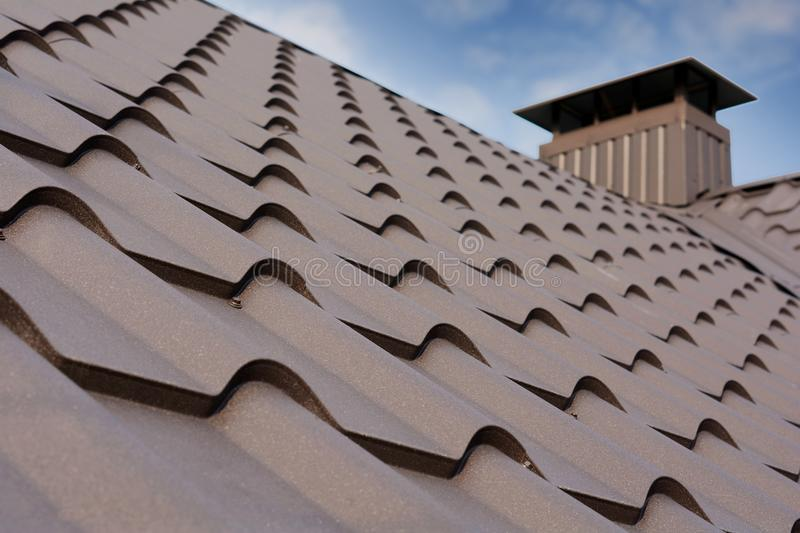 Metal Roof Construction Against Blue Sky. Roofing materials. Metal House roof. Closeup House Construction Building Materials. royalty free stock images