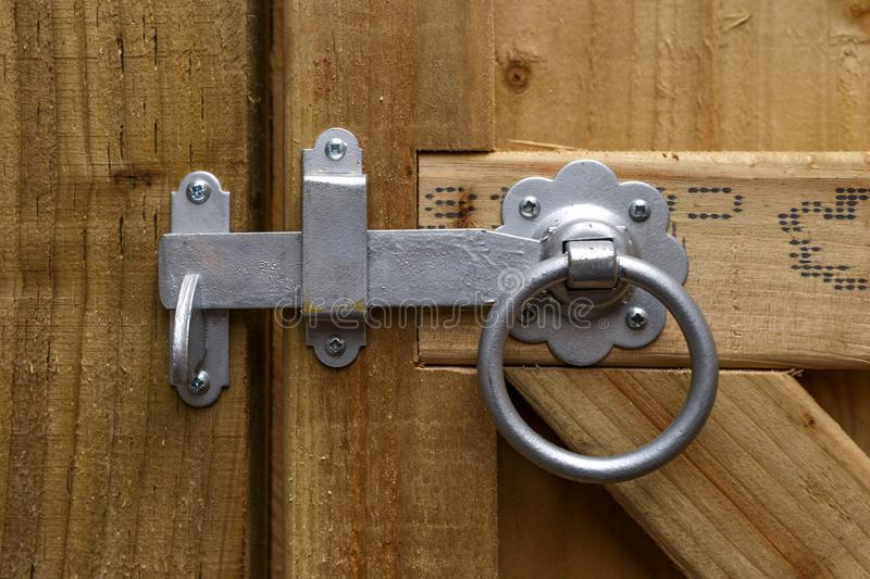 Metal Round Ring Latch Handle Fitted On Wooden garden gate.  royalty free stock photos