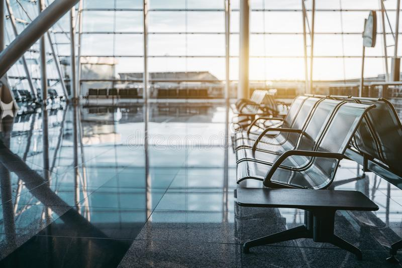 Metal row of seats in airport terminal stock photo