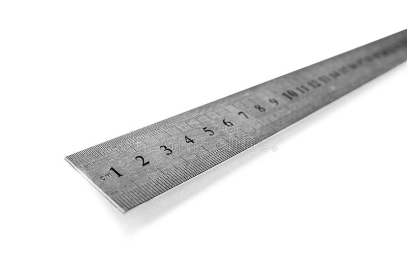 Metal ruler in centimeters or inches. Measuring tool on the white background. Metal ruler in centimeters or inches. Measuring tool on the white background stock photos