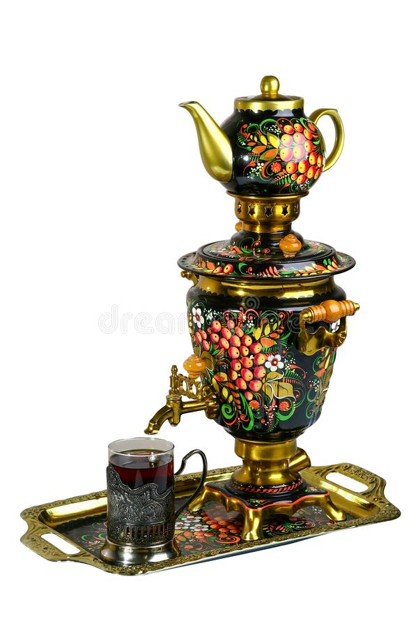 Metal Russian samovar, with traditional ornaments and paintings. On a white background royalty free stock photos