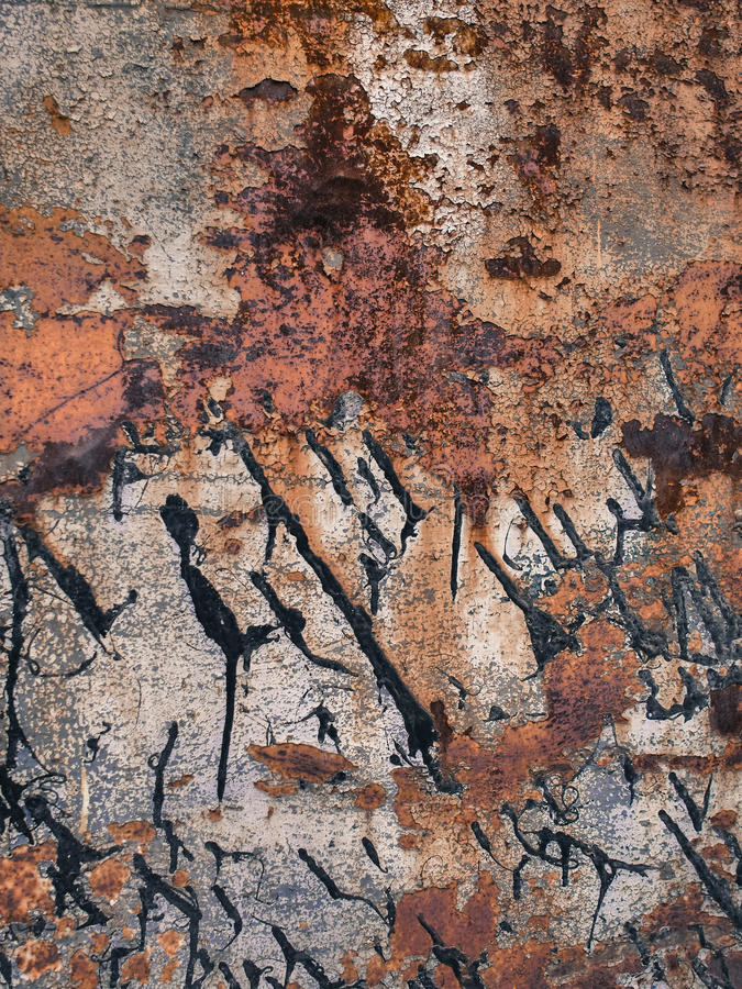 Eroded metal texture with black paint smudges, abstract grunge background royalty free stock photography
