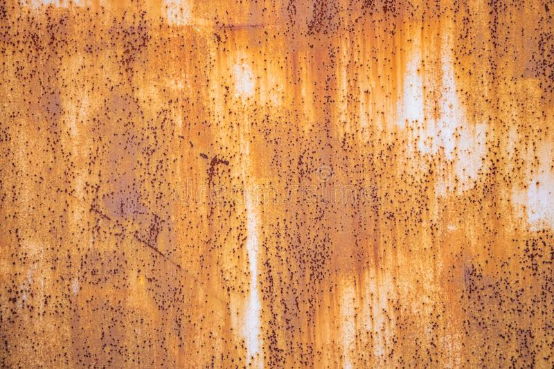 Metal rusty background texture. Heavy industrial steel plate corroded and peeled stock photography