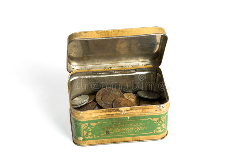 Metal rusty box with coins. Metal rusty box with old coins stock image