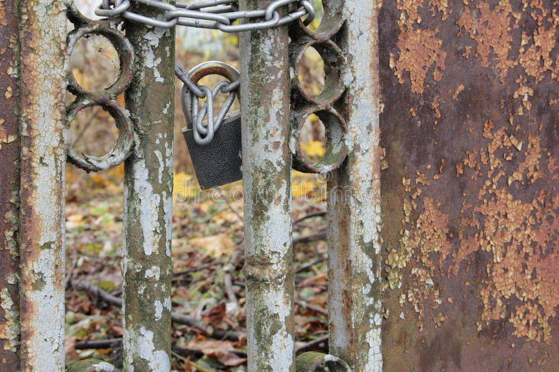 Metal rusty fence with lock. Metal rusty fence with lock near the brewery stock photography