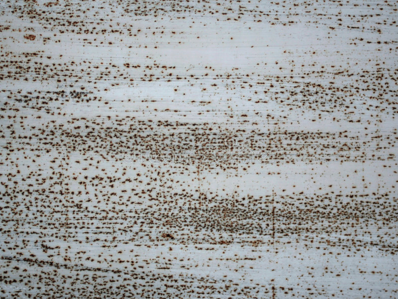Metal rusty surface. Metal painted white rusty surface royalty free stock image