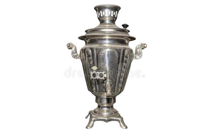 A metal samovar made in the old style for preparing tea, isolated on a white background with a clipping path. A metal samovar made in the old style for stock photos