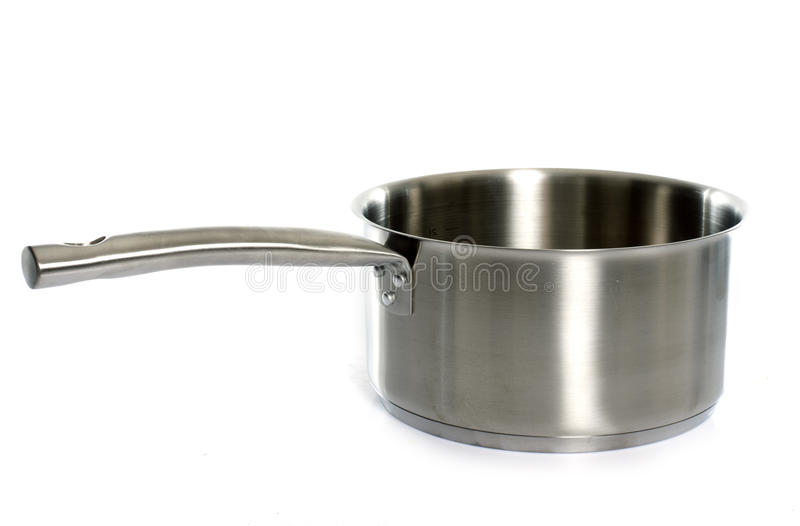 A metal saucepan. In front of white background stock image