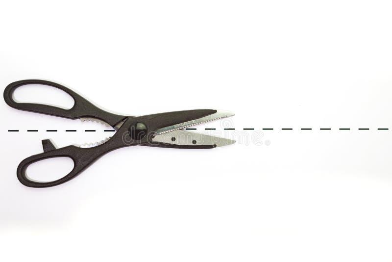 Metal scissor. Close - up black metal scissor on white background stock photos