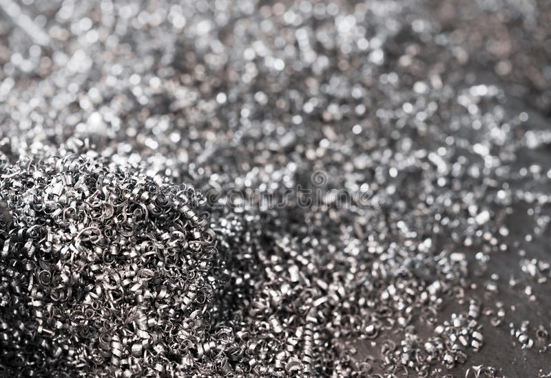 Metal scrap. Textured metal scrap background, shallow DOF royalty free stock photo