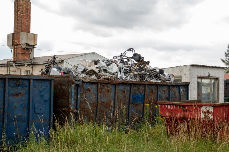 Metal scrap is located in large container. S stock image