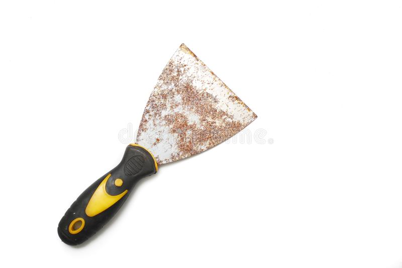 Used metal scraper tool. Metal scraper tool. Putty knife isolated white background stock photo