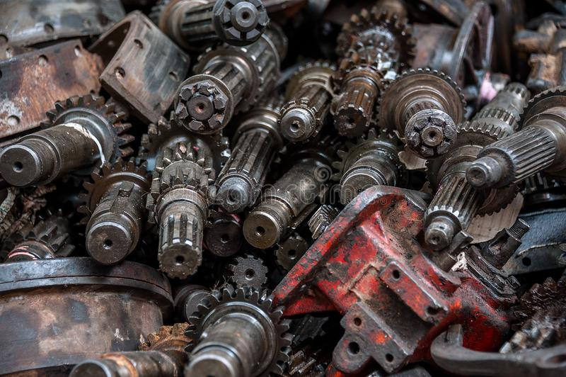 METAL SCRAPYARD, ENGINE PARTS, USED METAL GEARS. USED ENGINE PARTS. Pile of used engine parts stock image