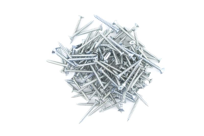 Metal screws isolated on white background royalty free stock photography