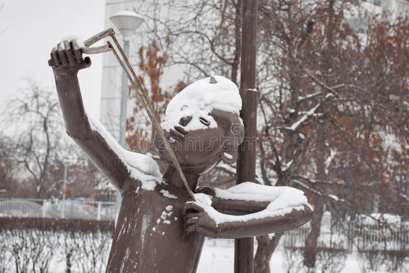 Metal sculpture of a boy stock photography