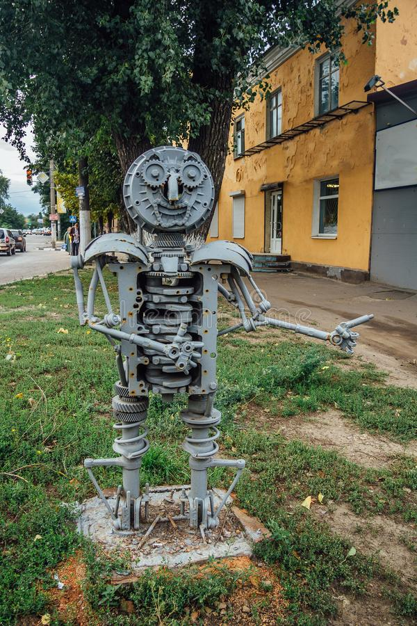 Metal sculpture of robot made from details of old cars and scrap metal stock images