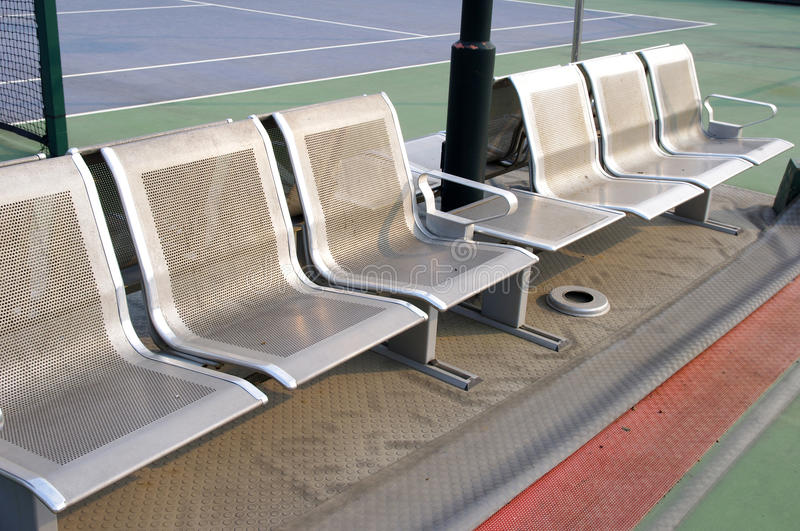 Metal seat. Tennis courts, rest of the metal seat stock photo