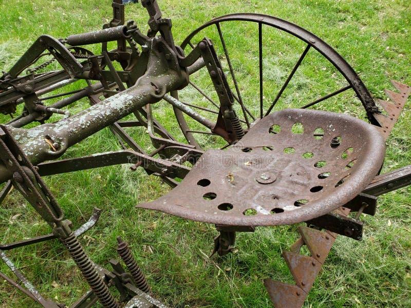 Metal seat on vintage farm machine stock photos
