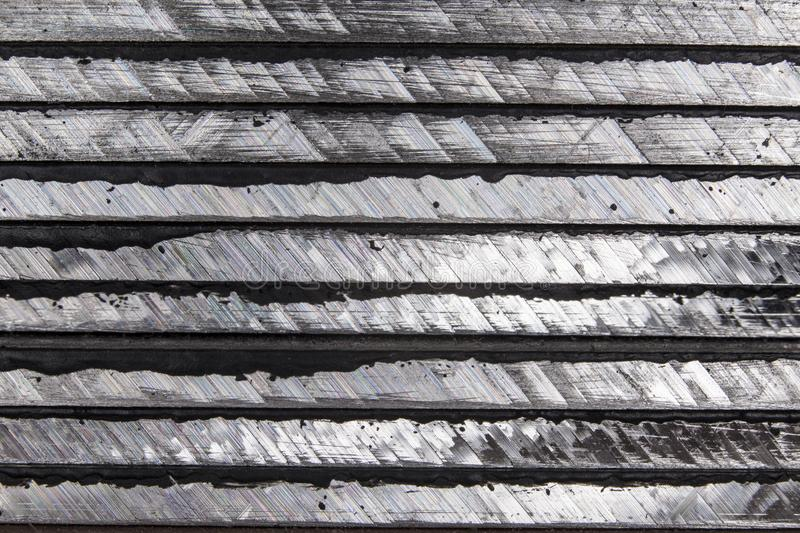Metal seen sideways, cleavage after sawing, background. S royalty free stock photos