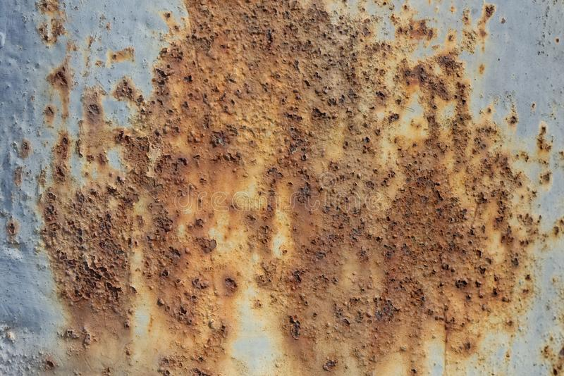 Metal sheet corroded rusty oxidized background significant texture. Little remaining color royalty free stock photo