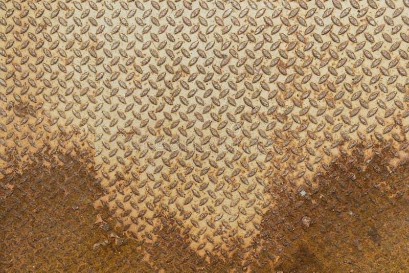 Metal sheet diamond plate floor material with rust stock photo