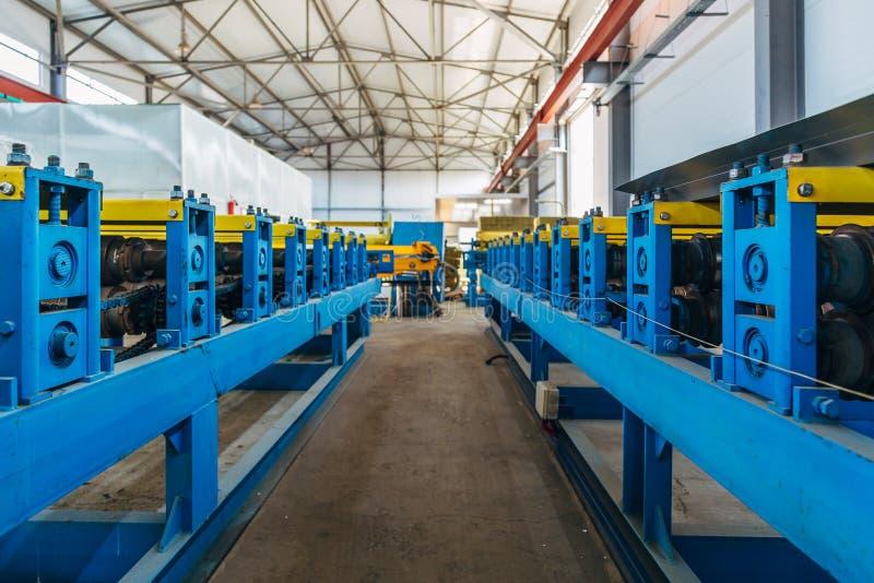 Metal sheet profiling factory. New modern metal sheet forming machinery.  royalty free stock photography
