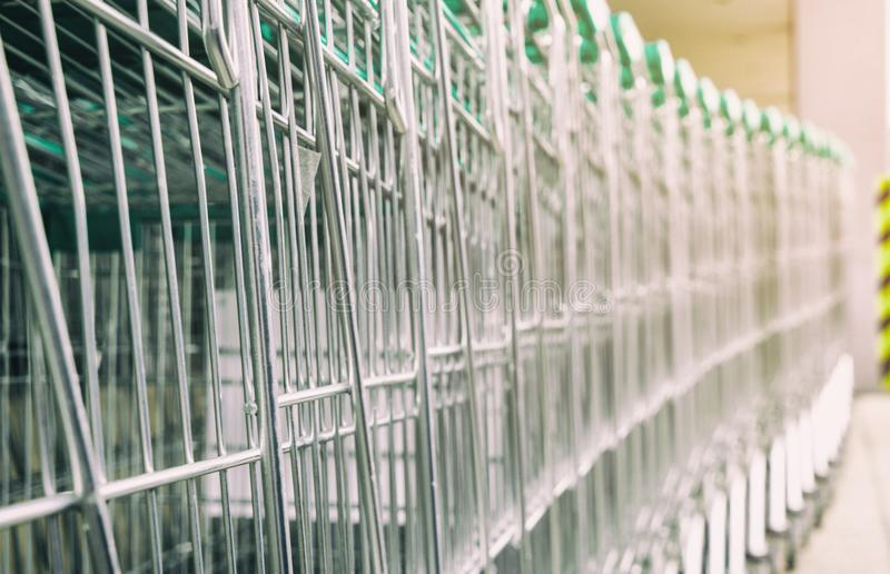 Metal shopping carts with green handle stock images