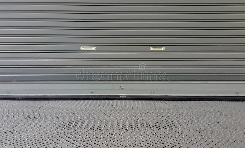Metal shutter door texture outside from warehouse stock photo