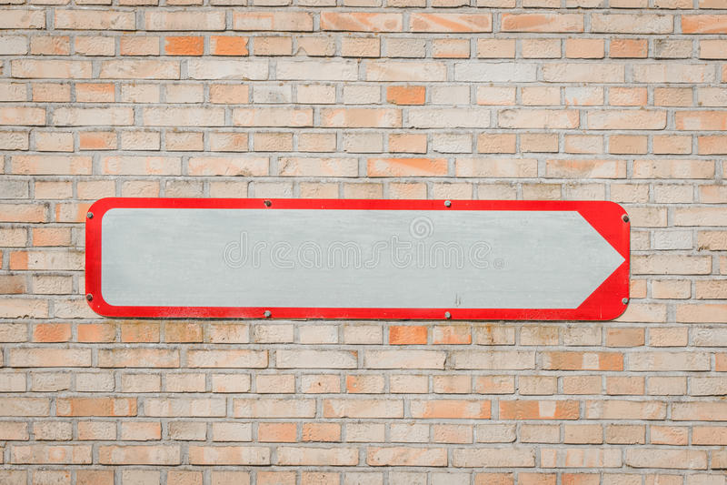 Metal sign with an arrow stock photo