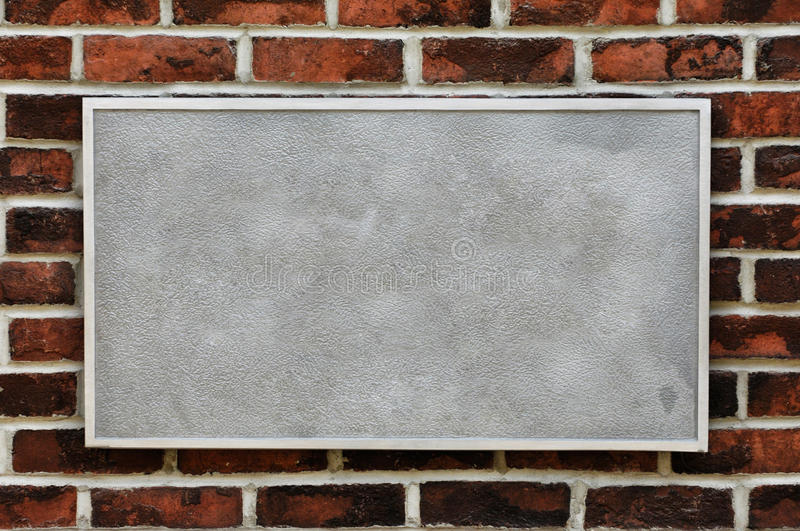 Download Metal Sign on Brick Wall stock photo. Image of plate - 17205200