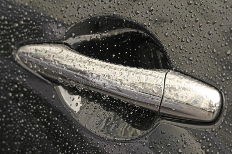 Metal Silver Handle of the Black Car in the Droplets of the Water and Rain. Car Wash.  royalty free stock images