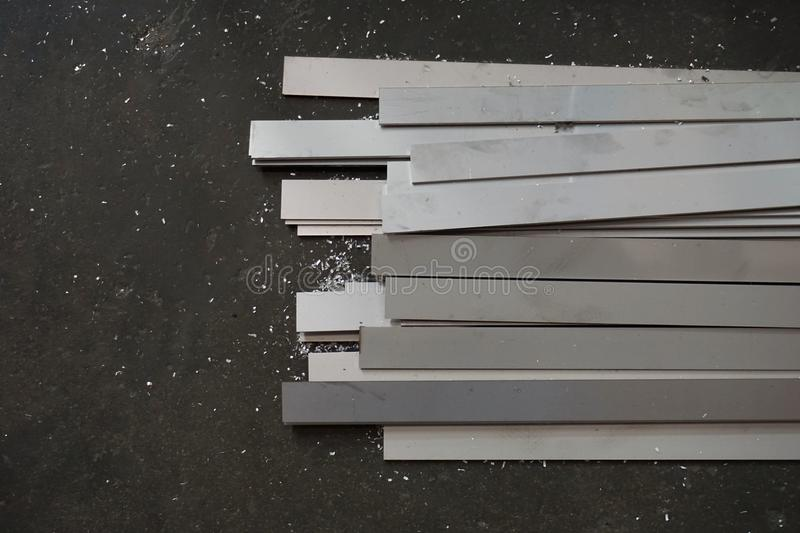 Metal slat. Group of metal slat on the concrete floor for background used stock photos