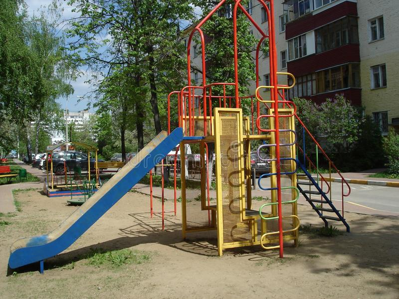 Metal slide for children in the summer courtyard stock photo