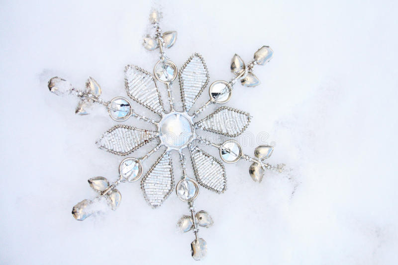 Download Metal Snow Flake In Snow  Christmas Decoration Stock Photo - Image: 83724739