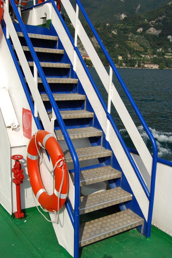 Metal staircase steps on a ship deck stock photos