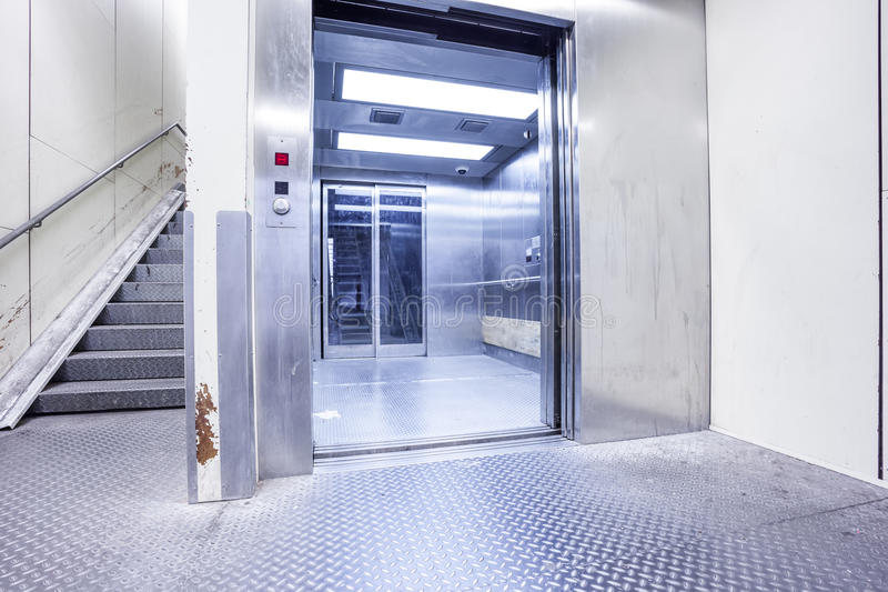 An metal staircase in a tunnel. In a big city, there`s a metal staircase in a tunnel just below a large river stock photos