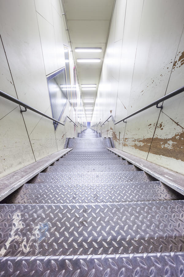 An metal staircase in a tunnel royalty free stock photos