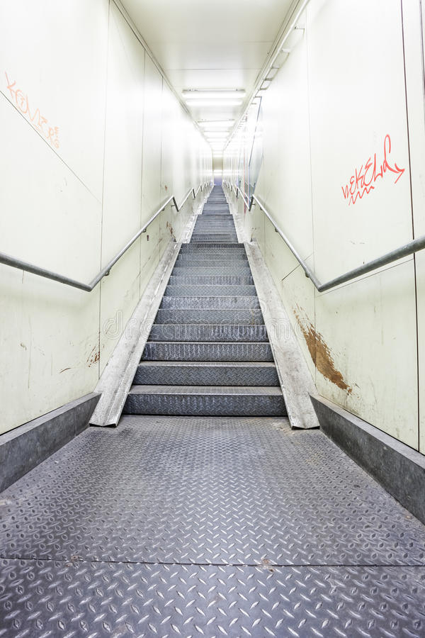 An metal staircase in a tunnel stock photography