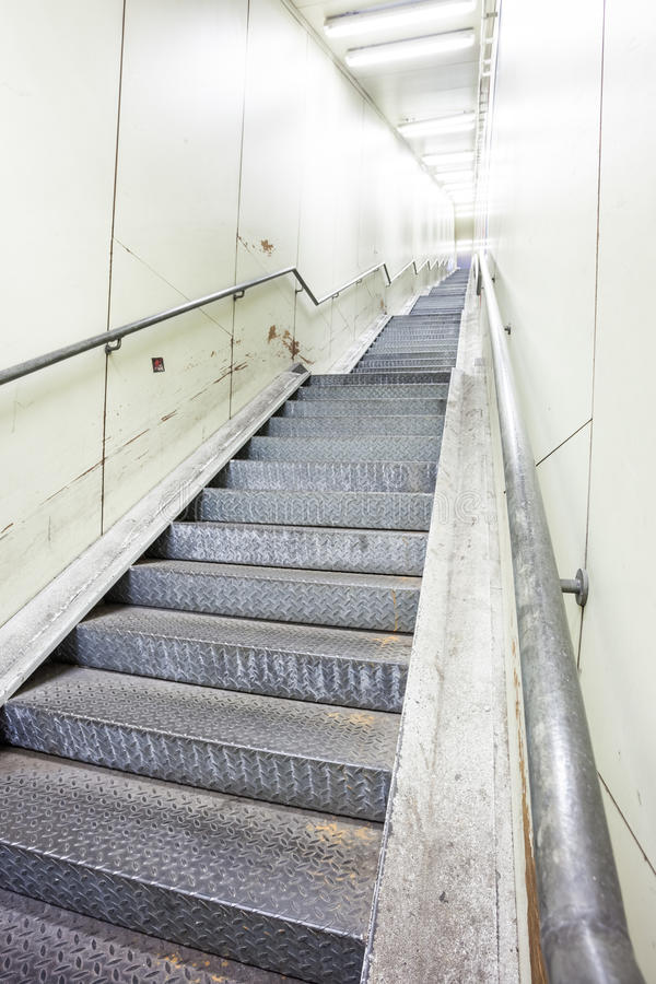 An metal staircase in a tunnel royalty free stock photography
